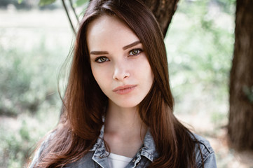 portrait of a beautiful girl closeup on street
