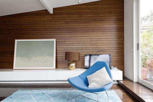 Horizontal wood panelling in mid century living room