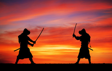 Silhouette of samurais in duel. Picture with two samurais and su