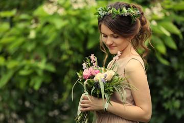 Beautiful bridesmaid holding bouquet