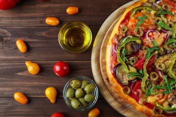 Tasty homemade pizza on table