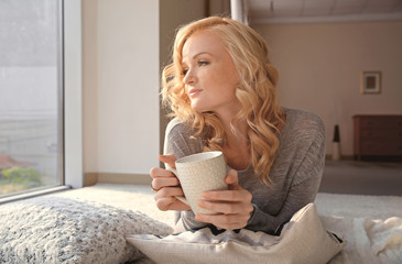 Beautiful girl drinking coffee at home
