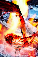 abstract image of a glass of wine and an open fire