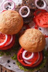 sandwiches: black bean burgers and fresh vegetables close-up. Vertical top view