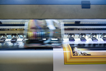 Printer machine inkjet during production on vinyl banner