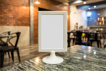 Label white blank on table top in restaurant