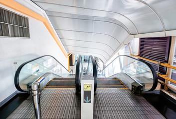 Tunnel escalator scroll down in urban