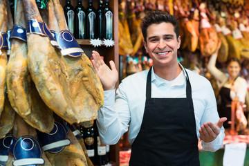 Worker selling Spanish jamon