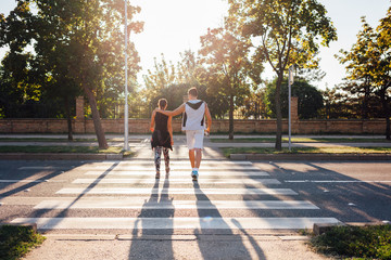 Couple crossing the street at the pedestrian crossing
