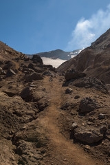 Rocky path leading into the Mutnovsky volcano crater, Kamchatka, Russia