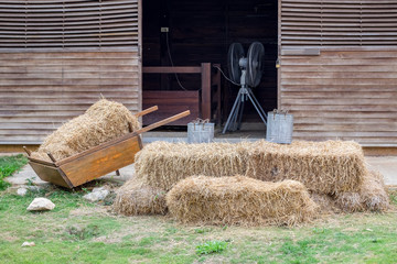 Cart with rick straw on barn