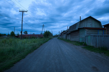 Empty streets of the remote village Kozyrevsk at sunset, Kamchatka, Russia