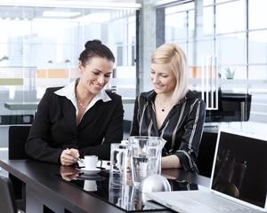 Businesswomen having coffee-break