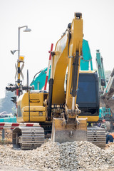 Backhoe and improvement construction of railway