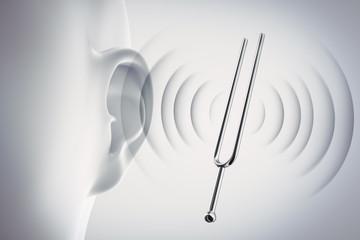 Ohr mit Stimmgabel und Schall