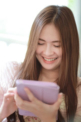 Beautiful asian girl using tablet