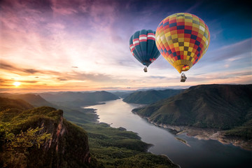 Colorful hot air balloons flying over on Mae Ping National Park