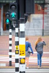 Pedestrians crossing at traffic lights