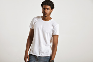 Anxious looking sexy young African American in blank white sleeveless t-shirt looking into the camera