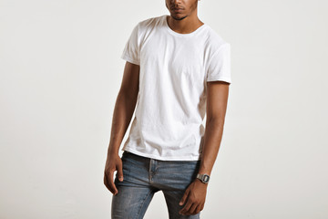 Unlabeled white cotton t-shirt presented on a muscular body of a young athlete