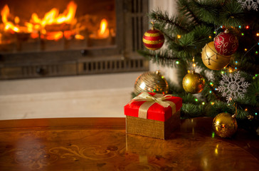 Christmas background with present, Christmas tree and burning fi