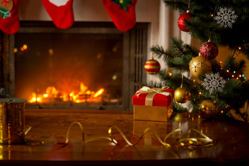 Christmas background with gift box on wooden table in front of b
