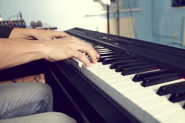 Playing the piano keyboard close up