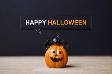 Happy Halloween message, Pumpkin on table wood with dark wall background, halloween concept. Fotoväggar