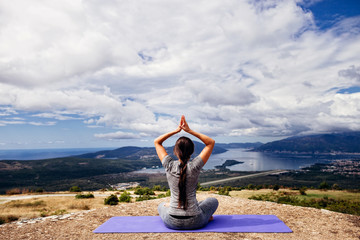 woman yoga relaxation in serene landscape