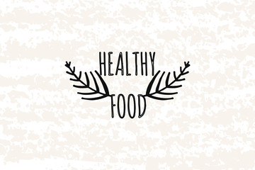Logo in the style of hand drawn. Hands drawn elements in a decorative box health food. Fresh natural products in the diet. Sticker, badge, card for production in print and stores. Vector