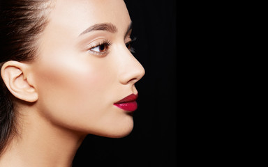 Beautiful woman profile isolated on black background. Cosmetic makeup image.