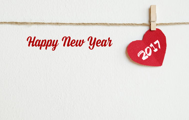 Red fabric heart with 2017 and happy new year word on white wall