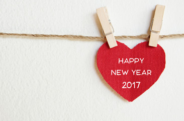 Red fabric heart with happy new year 2017 word
