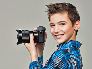 Boy with photo camera taking pictures.
