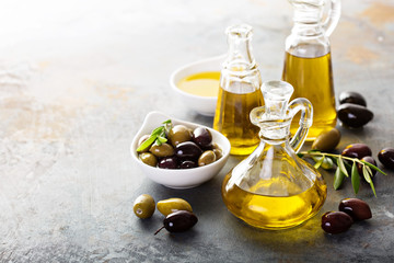 Olive oil in vintage bottles Wall mural