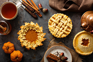 Homemade pumpkin pies decorated with fall leaves