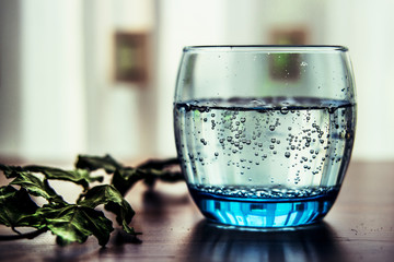 Pouring Mineral Water into the Glass.