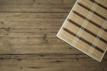 Wooden old background with braided napkin
