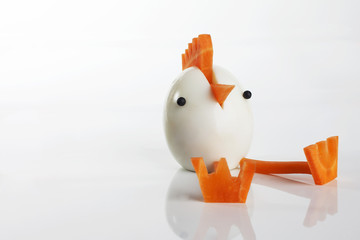 Food art creative concepts. Funny animals made of carrots and boiled egg over white background.