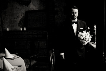 Black and white photo of the handsome groom