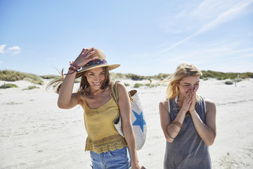 Two happy female friends on the beach