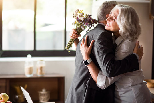 Happy elderly couple celebrating wedding anniversary