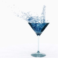 splash in a glass. water in a glass. wine is poured into a glass.