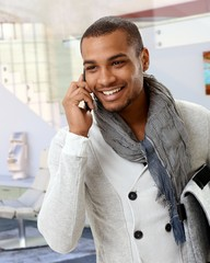 Trendy afro american man talking on mobile phone