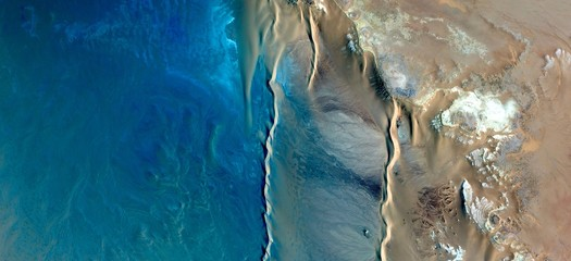 Caribbean beaches with turquoise waters in the middle of african desert from the air,mirage in the Sahara abstract photography naturalist from the deserts of Africa,waves,sea and sand in the dunes,
