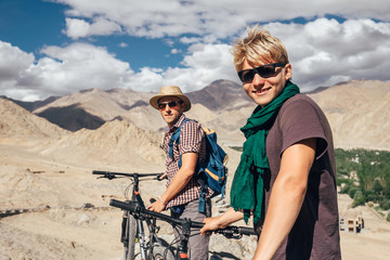 Two happy smiling mountain bikers in Himalaya mountain