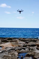 drone hovering over sea