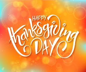 vector thanksgiving day greeting lettering phrase - happy thanksgiving day - on blur autumn background with flares