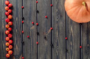 Apples,  Pumpkin, and beries  on wooden background. Thanksgiving, autumn, handmade