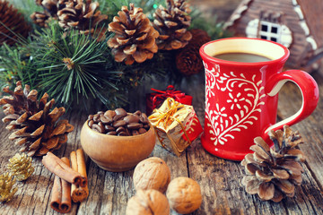 Cup of coffee, pine cones and New-Year tree decorations. Toned i